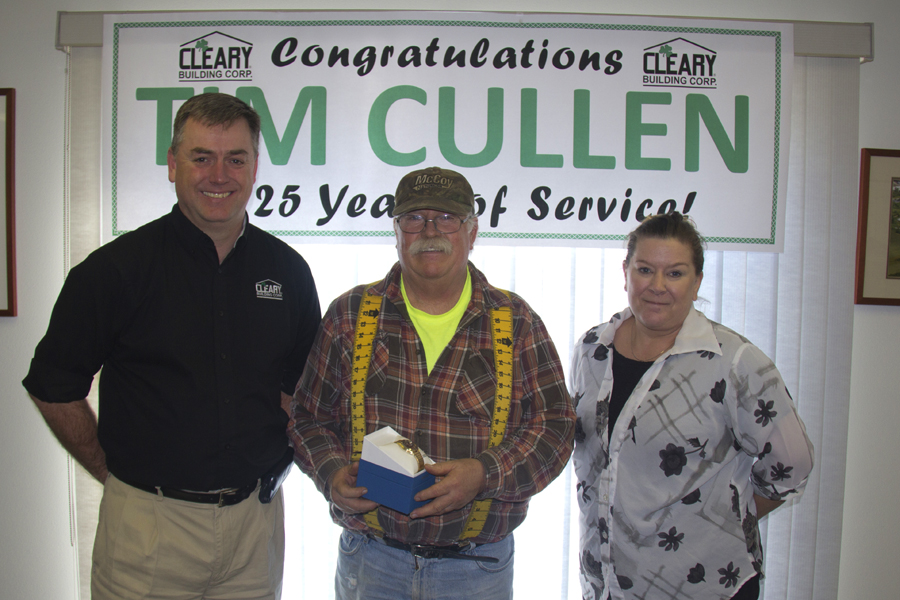 Tim Cullen, center, is presented with a congratulatory gold watch for 25 years of service with Cleary Building Corp., by Mark Wordley, Vice President of Operations, and Tracy Riese, Transportation Coordinator